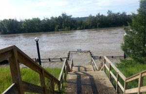 The flooded promenade at Louise McKinney Park-Edmonton Journal