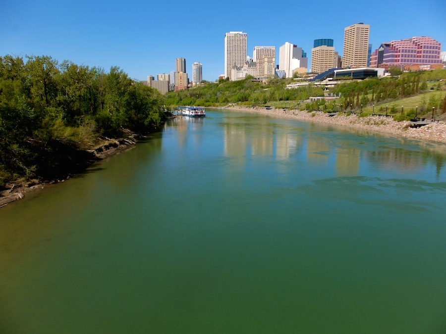The suddenly very green North Saskatchewan River